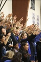 Students cheer on the boys' basketball team at a home game