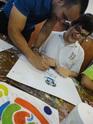 Teacher and student during art class.