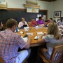 Phillips Exeter Academy Photo #3 - There are no desks, no lectures here. Students learn by listening and collaborating with a diverse group of peers around the Harkness table.