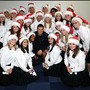 North Central Texas Academy Photo #3 - The NCTA choir has many opportunities to perform around the state, including the Dallas Cowboy Luncheon. Here, the choir poses with Tony Romo, the Cowboys quarterback.